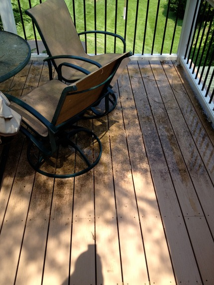 Marc's on the Glass composite deck cleaning with pressure washer, deck with black stains in greater richmond va