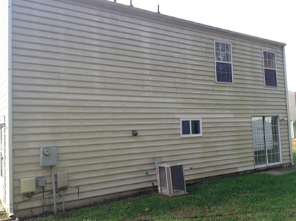 Marc's on the Glass pressure washing house with mold, mildew, green stuff on vinyl siding in richmond va