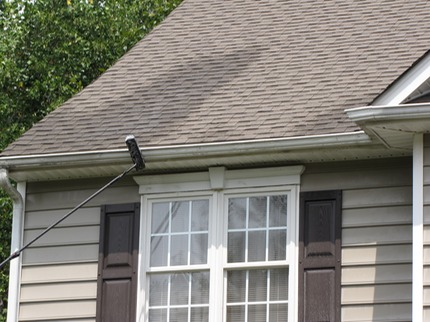 Marc's on the Glass gutter restoration, hand cleaning black stains on gutters in Richmond VA