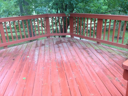 before picture of a deck in richmond that has a good stain, but is still susceptible to mold and algae.  just a basic soft wash will remove the problem and extend the life of the deck stain